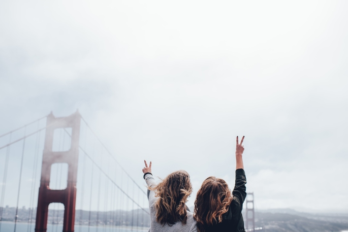 women-holding-up-peacesigns-ggb